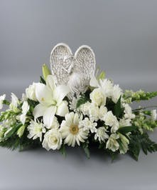 Centerpiece of all white flowers & keepsake of angel