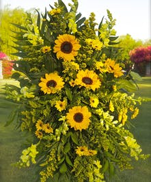 Standing spray with all yellow flowers and sunflowers