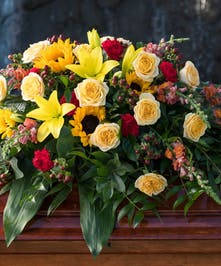 Casket Spray with assorted bright flowers with sunflowers and roses