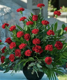 Sympathy Bouquet with red roses and red carnations