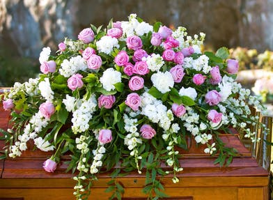 Casket Spray with pink roses and white accent flowers