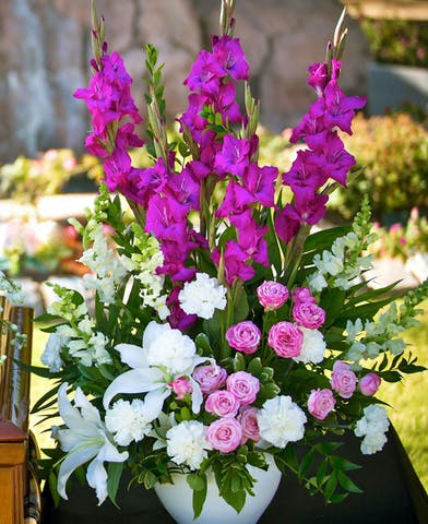 Sympathy arrangement in white and pink and vibrant purple