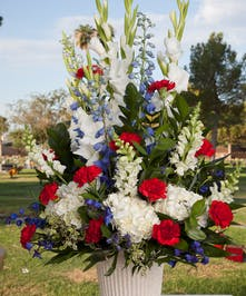 Sympathy design with red white and blue flowers