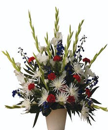 Sympathy design with patriotic flowers in red white and blue