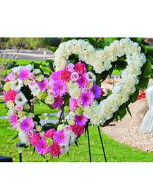 Double Heart Design with all pink flowers and the other heart in all white carnations