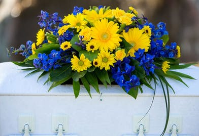 Youth Casket Spray in blue and yellow flowers