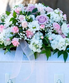 Youth Casket Spray in all white and pink flowers including roses
