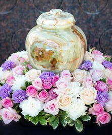 Urn Wreath with shades of pink roses and lavender and white carnations