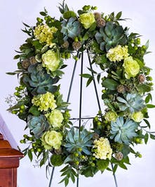 Oval wreath with succulents and green toned roses and flowers