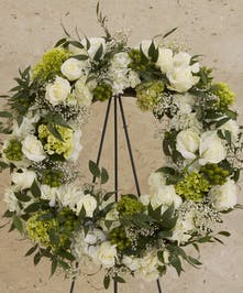 Wreath with all white flowers and roses and green accents