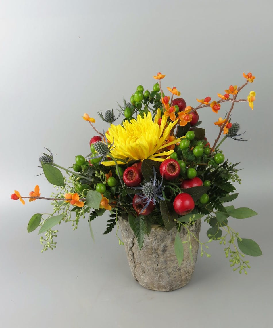 Rustic birch container with fall flowers and faux bittersweet branches appleas