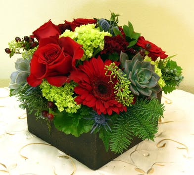 Red Roses and Red Flowers in a round centerpiece design