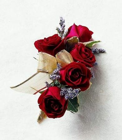 Red roses corsage with gold ribbon